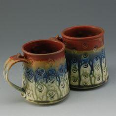 Pottery Mug with stamps handmade wheel thrown cinnamon brown blue fern green porcelain by Mark Hudak. $25.00, via Etsy.