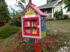 Patty Tompkins. Poulsbo, WA. I read about the Little Free Library a few years ago and thought what a great idea it was. So I asked a friend, Ralph Schulz, master woodworker to build me a two shelf unit. Then I saw some beautiful mosaic on Bainbridge Island and decided to add on a mosaic. It turned out that neighbor had recently opened up a mosaic store in downtown Poulsbo! She was such a great help to me. My daughter and husband helped too.