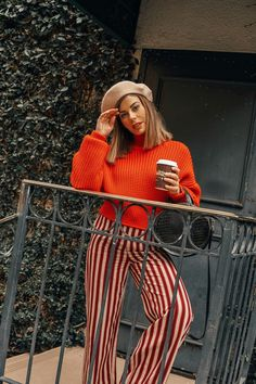 Fashion blogger Emily Vartanian shows us how to wear striped pants.