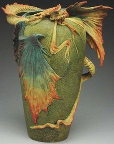 Eastern Dragon | Amphora Pottery - the detail in the dragon caught my eye and then you sink into the colors of the finish