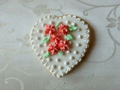 <3 <3 ADD diy www.customweddingprintables.com ... Heart shaped hand-decorated flower sugar cookie in Coral