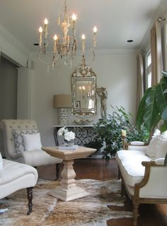 living rooms - Benjamin Moore - China White - french living room, french living room design, candle chandelier, china white, china white wal...
