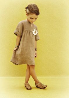 if only us grown up girls looked this adorable in a simple flour sack style dress