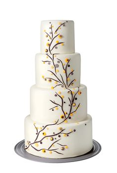 Brides.com: The Most Creative Wedding Cakes of the Year. Lulu Cake Boutique, Scarsdale, NY. If it's fall and you're getting married and want something seasonal, but not too on the nose, a subtle yellow and gray-hued cake like this one is just the ticket.  Four-tier white wedding cake, $9 per slice (serves 120), Lulu Cake Boutique  See more fall wedding cakes.