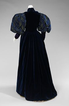 "Dress, Laboudt & Robina: 1895, French, silk. ""The crescent textile of this glorious gown was made in China in 1888 and then included in this gown by Parisian dressmakers Laboudt & Robina at a later date. The dress itself includes what French dressmaking is famous for: striking color combinations and textures, meticulous sewing and elaborate embroidery."" Back"