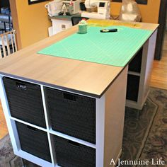 DIY Counter Height Craft Table Perfect craft table - I love to stand and this would be perfect! You could use those closet maid cubes found at Target. A Jennuine Life: DIY Counter Height Craft Table Craft Tables With Storage, Craft Room Tables, Craft Desk, Craft Room Storage, Diy Table, Diy Desk, Table Storage, Craft Rooms, Craft Table Ikea