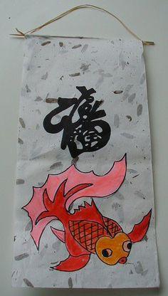 Porte bonheur décoré de lettres de l'alphabet chinois - alphabet chinois