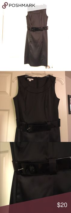 Classy black dress Perfect for the holiday party! Flattering cut, yet modest, with a thick shiny black belt at the waist which came with the dress, and is removable! Full zipper in the back. In the front, right below the belt, there is a pouch--it is not enclosed but kind of like pockets in a dress! A place for your phone! This was mine and I don't wear it bc I have too many. Nothing wrong with it! And, I just noticed the pouch, so if you are worried about it looking strange it definitely…