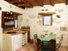Paliokaliva village is an ideal destination for couples and for family vacations next to the beach in Zakynthos, Greece offering affordable accommodation. Studio Apartment, Warm Colors, Villas, Apartments, Indoor, Luxury, Table, Furniture, Home Decor