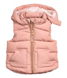 Dusky pink. Padded vest with a detachable, lined hood. Zip and pockets at front. Lined.
