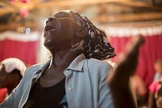 A Haitian woman praises God during a worship service at a church that missionary Carlos Llambes helped start. Through a church-planting institute he began five years ago in the Dominican Republic, Haitian and Dominican Baptists in the island nation have started nearly 100 new churches, many of them Haitian. - Wilson Hunter