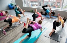 Yoga class in a modern studio by Cara Slifka - Class, Yoga - Stocksy United