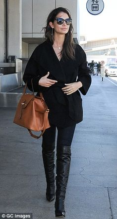 Looking good! The chic 28-year-old was seen sashaying around at LAX...
