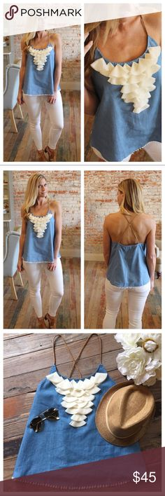"""Denim Petal Tunic So unique and cute! Denim with petal decoration in cream. Sweet edging along the bottom, and braided rawhide cord as straps. 100%cotton.Bust S17"""" M18"""" and L19"""". Measures flat length S25 M26"""" and L27"""". Tops"""