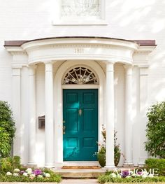 love this teal door...so striking and unusual (I love the door being painted any bright color!)