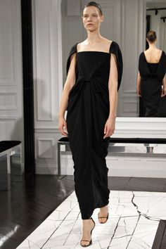 The most exciting interpretation of a portrait neck line i've ever seen.  For a lady of a certain age, it would be such an exciting moment being able to buy into the Alex Wang world with this beautifully cut, draped and designed evening dress.