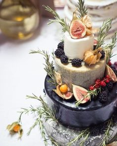 Fromage over frosting on your wedding day? Mais oui, if the cake comes out looking anything like this four-tiered tower of cheesy goodness, all dressed up in sweetness with blackberries, currants, figs, and physalis.
