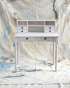 This desk and hutch, which has six drawers and four cubbies, can turn a modest amount of free space into a home office. With its soft whitewashed look, pickling is a perfect choice for a dainty desk such as this one. After sanding lightly, follow this process: Using natural-bristle brushes, apply one coat each of prestain conditioner, stain, and clear sealant. For a chic look, replace standard wooden knobs with oil-rubbed bronze pulls.