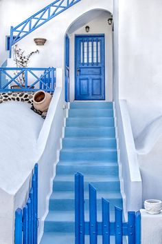 Beautiful blue and white staircase of a home in Santorini, Greece