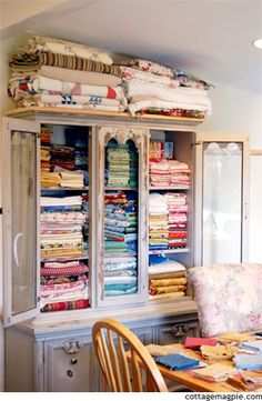 Love the stack of quilts on top of the storage cabinet