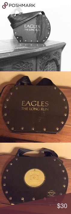 "Eagles ""The Long Run"" purse Record cover purse w/ black seatbelt straps.  Looks great with a black leather jacket! No pockets on the inside. Front and back made from wood & plastic and outlined in rivets. Bags Shoulder Bags"