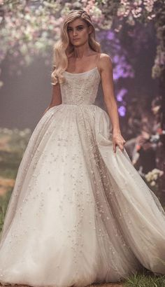 Tulle ball gown with fairy dust inspired beadwork, featuring the lyrics of Cinderella's, 'So This is Love'. A line embellishment a line wedding dress #wedding #weddingdress #weddinggown