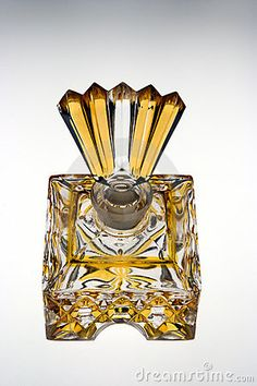 Photo about Glass antique perfume bottle in clear and yellow glass. Image of scent, bottle, cosmetics - 7299842