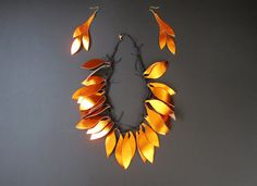 Every day statement necklace for every occasion. Leather necklace and earrings in tribal style.   The gold orange genuine leather leaves are hand cut and affixed to the cotton cord  lobster clasp.   Maximal neck circumference ca 52 cm. minimal - 40 cm   more pics about my work process moments on Instagram: https://www.instagram.com/mashabitterjewelry/  If you are interested or you want to see more pictures of item, or have any questions, do not hesitate to contact me