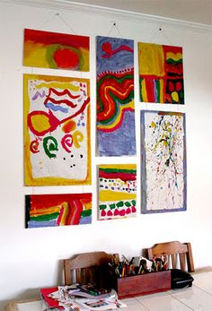 """hilarious idea!! love ---- """"We needed something big to fill the white wall space above our kitchen table, so rather than getting the girls to collaborate on one big piece, I thought we'd try a lot of smaller """"canvases"""" that could be put together to make a larger one."""""""
