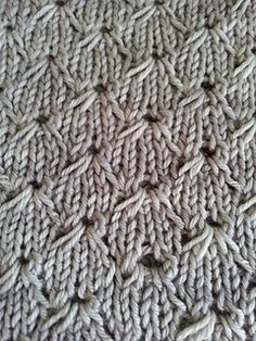 A simple cowl utilizing a Broderie Anglaise design. The pattern repeat is only 8 rows (knit 4 rows, and then knit them again, just two stitches offset), and is super easy to memorize. You can make it bigger (or smaller) by adding stitches in any multiple of 8.