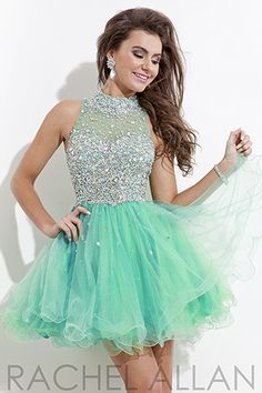 Heavily embellished soft tulle dress with AB stones and high neckline.