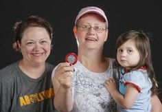 #RiverFest2014  Andrea Anglin, left, found the Wichita Eagle Medallion near the John Mack Bridge on Wednesday. She plans to sell their winnings and use the proceeds to help her friend, who is battling Stage 3 Breast Cancer