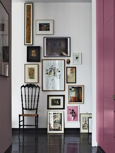 Eclectic gallery wall of framed artwork on a narrow wall with a stair step layout - Gallery Wall Ideas & Decor