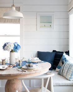 Bright Interiors blue and white coastal breakfast nook built in bench seating round wooden table, shiplap wall