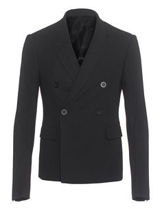Schurwoll-Sakko Schmal geschnittenes schwarzes Sakko aus edler Schurwolle gefertigt mit doppelter Knopfleiste, einer Innentasche und zwei Klapptaschen auf der Front.  Egal ob casual oder chic gestyled, dieses Fashion-Piece darf in keinem Kleiderschrank fehlen!
