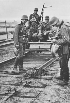 "derpanzergraf: ""A handcar patrol inspecting evidence of saboteurs "" Ww1 Photos, Germany Ww2, Afrika Korps, Akashic Records, The Third Reich, Korean War, German Army, Panzer, American Revolution"