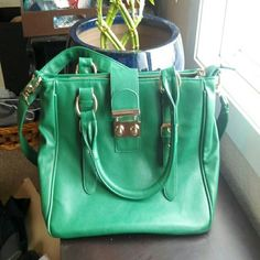 WEEKEND SALE Kelly Green purse Nice bright green color. Sized 13.5x9 in. Adjustable shoulder strap that is removable, Manmade materials. Slight damage on lower piping trim in 2 spots, and a few tiny pinpoint spots on bag. All areas have been touched up with professional matching leather paint.  Interior clean, but has several pen marks and one light small stain spot. Very cheerful color. See post 2/2 for more pics. Thanks :) Flying Tomato Bags Crossbody Bags