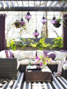 Love the pendant lights hanging from the pergola!