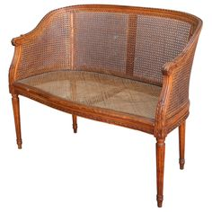 """Hand carved walnut Louis XVI style banquette with caned seat and double caned sides, c. 1880. 33"""" H X 41"""" W X 21"""" D 17"""" H to seat"""