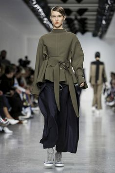 At Eudon Choi, the starting point may have been the austere Austrian modernist Adolf Loos - but the outcome saw Choi's slouchy, outsize separates energised with jolts of pumpkin, jade and ...