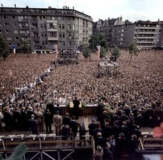 "A crowd of 450,000 listens as JFK delivers his 1963 ""Ich bin ein Berliner"" speech"
