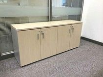 4-door bleached oak credenza with silver handles.