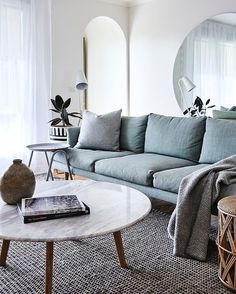 Turquoise sofa & marble coffee table @bicker_design