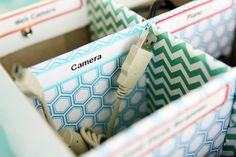 Jen of I Heart Organizing lived up to her site's moniker with her colorfully adorned and neatly organized cord storage boxes made from scrap pieces of cardboard, cut and slotted into individual compartments. She took the project to another level by using scrapbook paper to decorate the interior of each section, with Martha Stewart file folder labels clearly marking the purpose of each stored peripheral