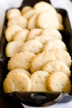 Homemade ritz crackers 2 cups all-purpose flour 3 tsp baking powder 1 tbsp sugar 1/2 tsp + another 1/2 tsp salt for topping 6 tbsp cold unsalted butter + 3 tbsp unsalted butter, melted 2 tbsp vegetable oil 2/3 cup water