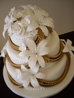 Flowers and drapes wedding cake