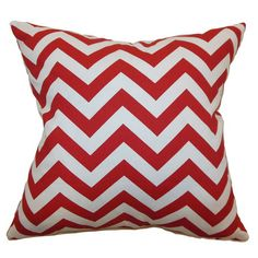 Bring a pop of color to your sofa or favorite arm chair with this cotton pillow, showcasing a red chevron motif.   Product: Pillow