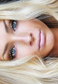 blonde healthy hair, tan and eyelashes