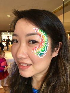 A rainbow face painting design.