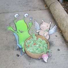 Sluggo and Philomena enjoying some fresh-picked vegetables … minus one that's clearly hoping to get away - . Chalk Art by David Zinn Murals Street Art, 3d Street Art, Amazing Street Art, Street Artists, Graffiti Artists, Chalk Artist, 3d Chalk Art, Art 3d, David Zinn